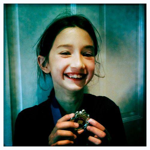 Happy medal girl